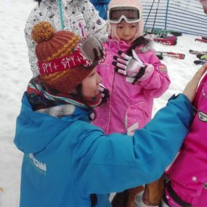 GoSnow instructor helping a little skier.